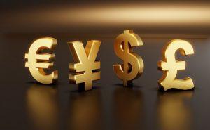 symbole walut na złotym tle